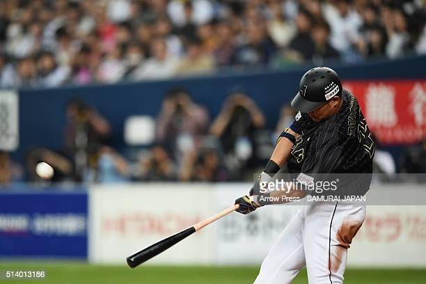 Outfielder Yoshitomo Tsutsugo of Japan hits a two run homer in the top of ninth inning during the international friendly match between Japan and...