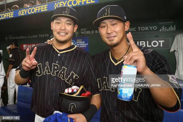 Outfielder Yoshitomo Tsutsugoh and Infielder Sho Nakata of Japan pose for photographs after the World Baseball Classic Pool B Game Three between...