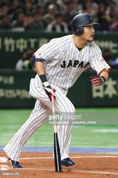 Outfielder Yoshitomo Tsutsugoh of Japan hits a RBI single to make it 01 in the bottom of the first inning during the World Baseball Classic Pool B...