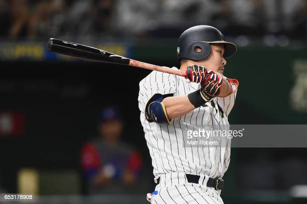Outfielder Yoshitomo Tsutsugoh of Japan hits a RBi single to make it 22 in the bottom of the third inning during the World Baseball Classic Pool E...