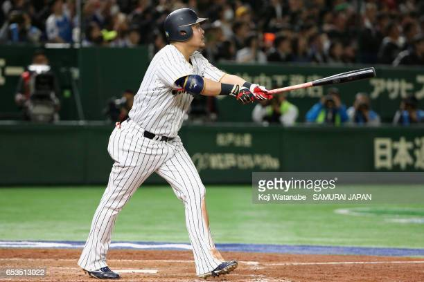Outfielder Yoshitomo Tsutsugoh of Japan hits a solo homerun in the bottom of the sixth inning during the World Baseball Classic Pool E Game Six...