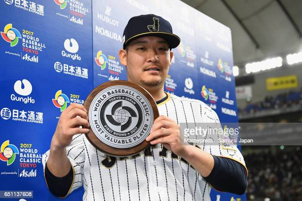 Outfielder Yoshitomo Tsutsugoh of Japan is awarded the Most Valuable Player award for the Frist Round Pool B after the World Baseball Classic Pool B...