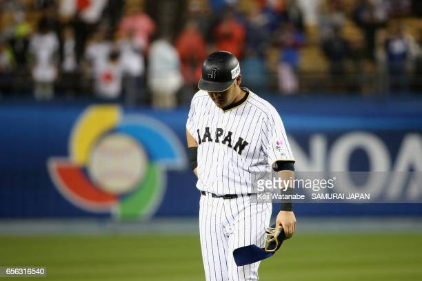 Outfielder Yoshitomo Tsutsugoh of Japan reacts after lining out in the bottom of the eighth inning during the World Baseball Classic Championship...