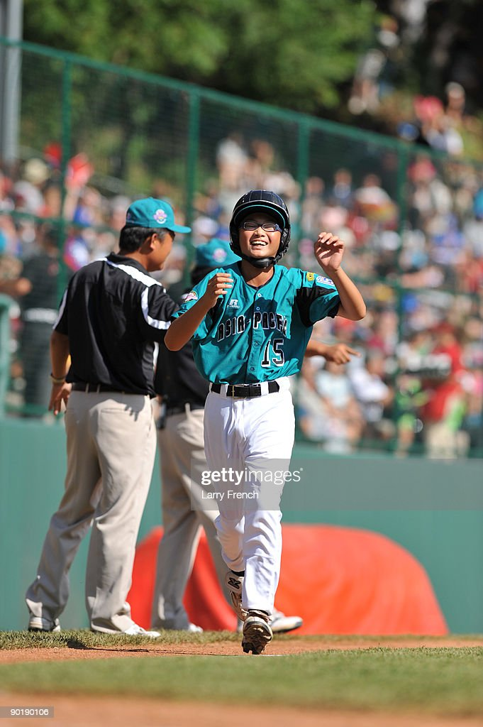 Outfielder Yuan Ting Ti #15 of Asia Pacific (Taoyuan, Taiwan) scores a run against California (Chula Vista) in the little league world series final at Lamade Stadium on August 30, 2009 in Williamsport, Pennsylvania.