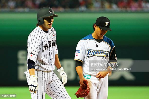 Outfielder Yuki Yanagita of Samurai Japan hits a double during in the bottom half of the nineth inning the friendly match between Samurai Japan and...