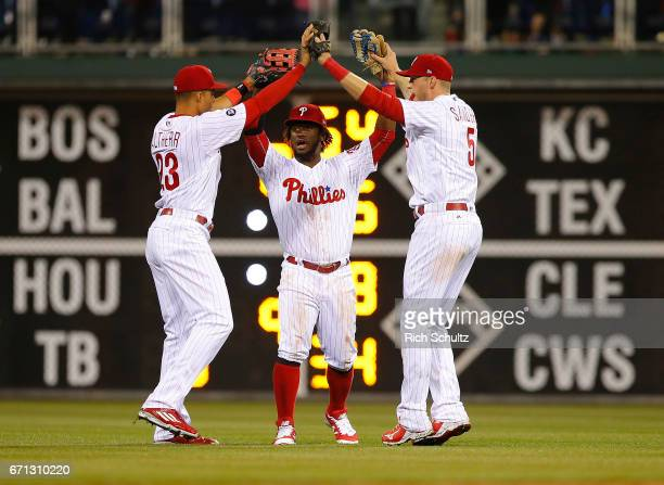 Outfielders Aaron Altherr Odubel Herrera and Michael Saunders of the Philadelphia Phillies celebrate after defeating the Atlanta Braves 43 during a...