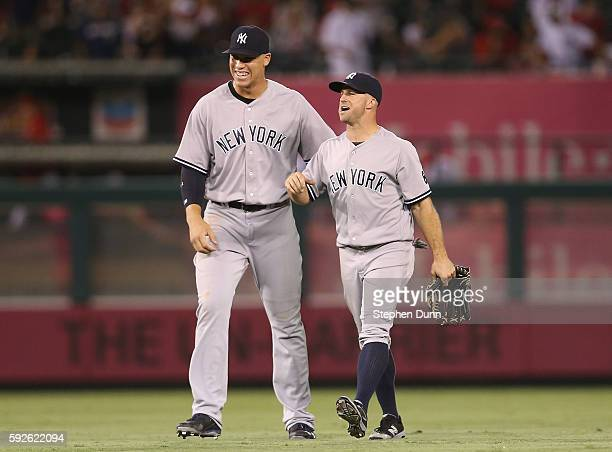 Outfielders Aaron Judge and Brett Gardner of the New York Yankees celebrate after the game against the Los Angeles Angels of Anaheim at Angel Stadium...