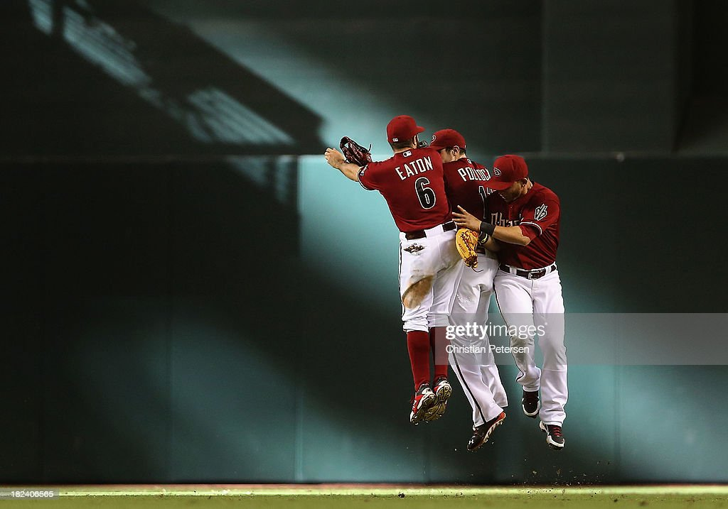 Outfielders <a gi-track='captionPersonalityLinkClicked' href=/galleries/search?phrase=Adam+Eaton&family=editorial&specificpeople=210898 ng-click='$event.stopPropagation()'>Adam Eaton</a> #6, A.J. Pollock #11 and <a gi-track='captionPersonalityLinkClicked' href=/galleries/search?phrase=Gerardo+Parra&family=editorial&specificpeople=4959447 ng-click='$event.stopPropagation()'>Gerardo Parra</a> #8 of the Arizona Diamondbacks celebrate following the MLB game against the Washington Nationals at Chase Field on September 29, 2013 in Phoenix, Arizona. The Diamondbacks defeated the Nationals 3-2.