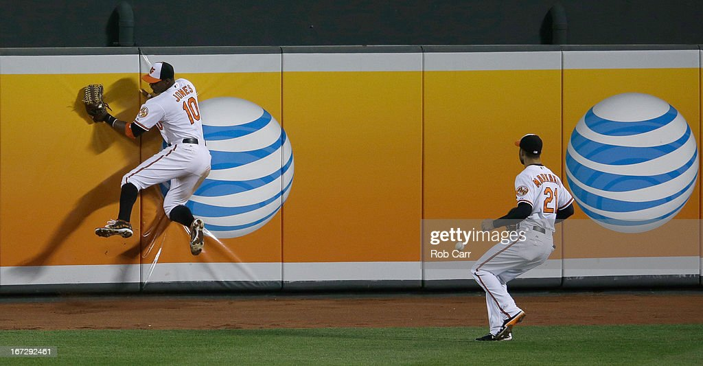 Outfielders Adam Jones #10 and <a gi-track='captionPersonalityLinkClicked' href=/galleries/search?phrase=Nick+Markakis&family=editorial&specificpeople=614708 ng-click='$event.stopPropagation()'>Nick Markakis</a> #21 of the Baltimore Orioles go after a triple hit by Melky Cabrera #53 of the Toronto Blue Jays (not pictured) during the sixth inning of the Orioles 4-3 win at Oriole Park at Camden Yards on April 23, 2013 in Baltimore, Maryland.