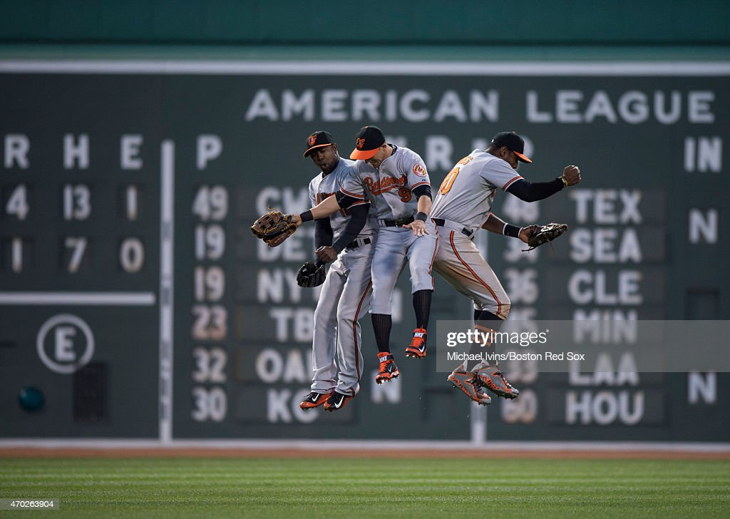 Outfielders <a gi-track='captionPersonalityLinkClicked' href=/galleries/search?phrase=Alejandro+De+Aza&family=editorial&specificpeople=4181650 ng-click='$event.stopPropagation()'>Alejandro De Aza</a> #12, <a gi-track='captionPersonalityLinkClicked' href=/galleries/search?phrase=David+Lough&family=editorial&specificpeople=6780100 ng-click='$event.stopPropagation()'>David Lough</a> #9 and <a gi-track='captionPersonalityLinkClicked' href=/galleries/search?phrase=Adam+Jones+-+Baseball+Player&family=editorial&specificpeople=5460465 ng-click='$event.stopPropagation()'>Adam Jones</a> #10 of the Baltimore Orioles celebrate a 4-1 victory over the Boston Red Sox at Fenway Park in Boston, Massachusetts on April 18, 2015.