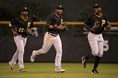 Outfielders Andrew McCutchen Starling Marte and Gregory Polanco of the Pittsburgh Pirates celebrate their victory over the Colorado Rockies at Coors...