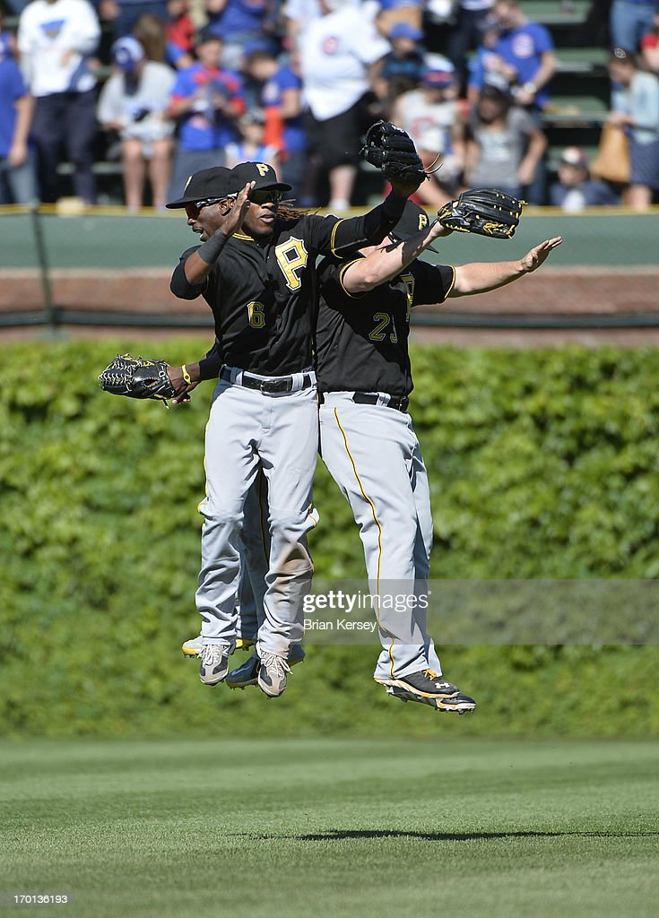 Outfielders <a gi-track='captionPersonalityLinkClicked' href=/galleries/search?phrase=Andrew+McCutchen&family=editorial&specificpeople=2364814 ng-click='$event.stopPropagation()'>Andrew McCutchen</a> #22 (L-R), <a gi-track='captionPersonalityLinkClicked' href=/galleries/search?phrase=Starling+Marte&family=editorial&specificpeople=7934200 ng-click='$event.stopPropagation()'>Starling Marte</a> #6 and <a gi-track='captionPersonalityLinkClicked' href=/galleries/search?phrase=Travis+Snider&family=editorial&specificpeople=4959427 ng-click='$event.stopPropagation()'>Travis Snider</a> #23 of the Pittsburgh Pirates celebrate a win over the Chicago Cubs at Wrigley Field on June 7, 2013 in Chicago, Illinois. The Pirates defeated the Cubs 2-0.