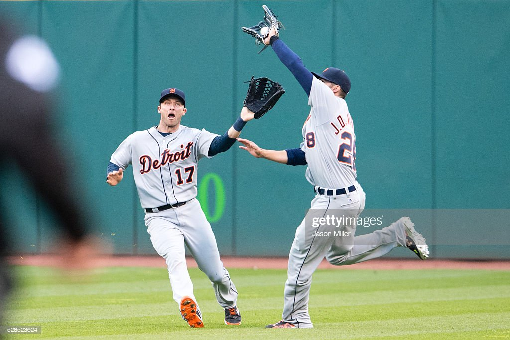 Outfielders <a gi-track='captionPersonalityLinkClicked' href=/galleries/search?phrase=Andrew+Romine&family=editorial&specificpeople=2338123 ng-click='$event.stopPropagation()'>Andrew Romine</a> #17 and <a gi-track='captionPersonalityLinkClicked' href=/galleries/search?phrase=J.D.+Martinez&family=editorial&specificpeople=7520024 ng-click='$event.stopPropagation()'>J.D. Martinez</a> #28 of the Detroit Tigers run into each other catching a fly ball hit by Juan Uribe #4 of the Cleveland Indians to end the fifth inning at Progressive Field on May 5, 2016 in Cleveland, Ohio.