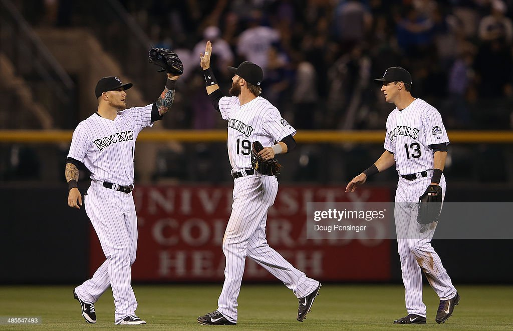 Outfielders Brandon Barnes #1, <a gi-track='captionPersonalityLinkClicked' href=/galleries/search?phrase=Charlie+Blackmon&family=editorial&specificpeople=7519880 ng-click='$event.stopPropagation()'>Charlie Blackmon</a> #19 and <a gi-track='captionPersonalityLinkClicked' href=/galleries/search?phrase=Drew+Stubbs+-+Baseball+Player&family=editorial&specificpeople=4498334 ng-click='$event.stopPropagation()'>Drew Stubbs</a> #13 of the Colorado Rockies celebrate their 12-1 victory over the Philadelphia Phillies at Coors Field on April 18, 2014 in Denver, Colorado.