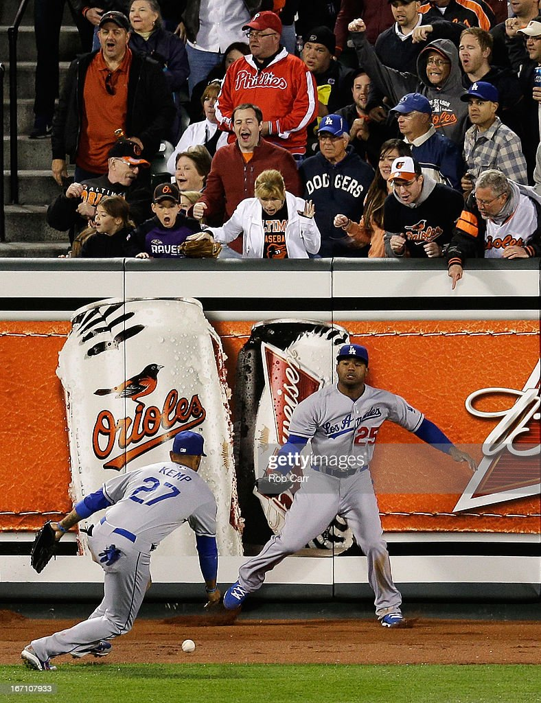 Outfielders <a gi-track='captionPersonalityLinkClicked' href=/galleries/search?phrase=Carl+Crawford&family=editorial&specificpeople=208074 ng-click='$event.stopPropagation()'>Carl Crawford</a> #25 and <a gi-track='captionPersonalityLinkClicked' href=/galleries/search?phrase=Matt+Kemp&family=editorial&specificpeople=567161 ng-click='$event.stopPropagation()'>Matt Kemp</a> #27 of the Los Angeles Dodgers go after an RBI double hit by Adam Jones #10 of the Baltimore Orioles (not pictured) in the fifth inning during game two of a double header at Oriole Park at Camden Yards on April 20, 2013 in Baltimore, Maryland.