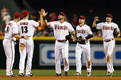 Outfielders David Peralta Ender Inciarte and AJ Pollock of the Arizona Diamondbacks highfive Nick Ahmed after defeating the New York Mets 72 in the...