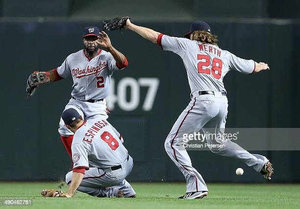 Outfielders Denard Span Danny Espinosa and Jayson Werth of the Washington Nationals come together as they are unable to catch a ball hit by Martin...