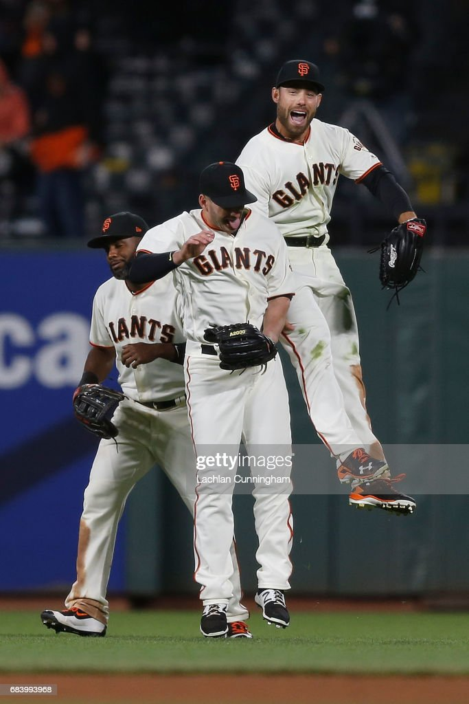 Outfielders Denard Span #2, Justin Ruggiano #39 and Mac Williamson #51of the San Francisco Giants celebrate a win against the Los Angeles Dodgers at AT&T Park on May 16, 2017 in San Francisco, California.