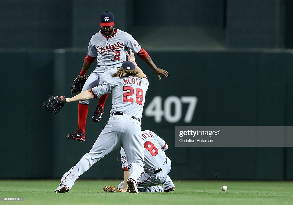 Outfielders <a gi-track='captionPersonalityLinkClicked' href=/galleries/search?phrase=Denard+Span&family=editorial&specificpeople=835844 ng-click='$event.stopPropagation()'>Denard Span</a> #2,<a gi-track='captionPersonalityLinkClicked' href=/galleries/search?phrase=Jayson+Werth&family=editorial&specificpeople=206490 ng-click='$event.stopPropagation()'>Jayson Werth</a> #28 and <a gi-track='captionPersonalityLinkClicked' href=/galleries/search?phrase=Danny+Espinosa&family=editorial&specificpeople=4410764 ng-click='$event.stopPropagation()'>Danny Espinosa</a> #8 of the Washington Nationals come together as they are unable to catch a ball hit by Martin Prado (not pictured) of the Arizona Diamondbacks during the first inning of the MLB game at Chase Field on May 14, 2014 in Phoenix, Arizona. The Nationals defeated the Diamondbacks 5-1.