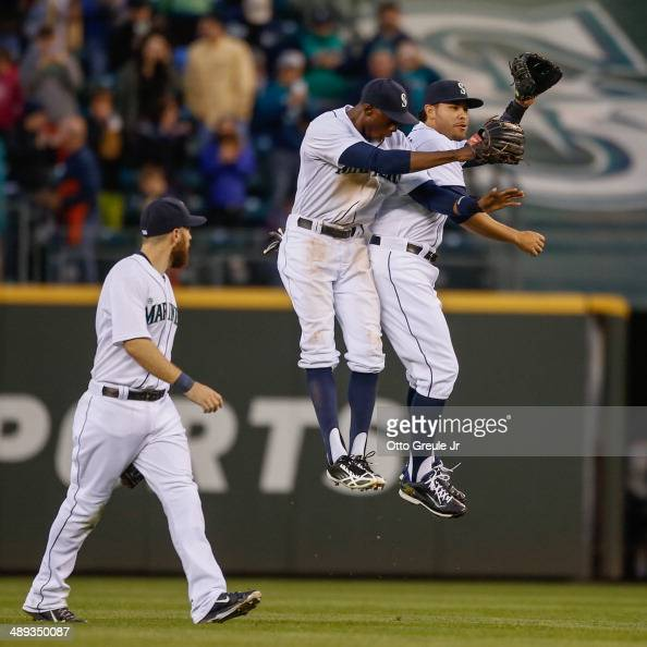 Outfielders Dustin Ackley James Jones and Stefen Romero of the Seattle Mariners celebrate after defeating the Kansas City Royals 31 at Safeco Field...