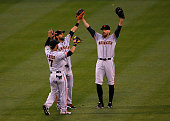 Outfielders Gregor Blanco Angel Pagan and Hunter Pence of the San Francisco Giants celebrate their 108 victory over the Colorado Rockies during the...