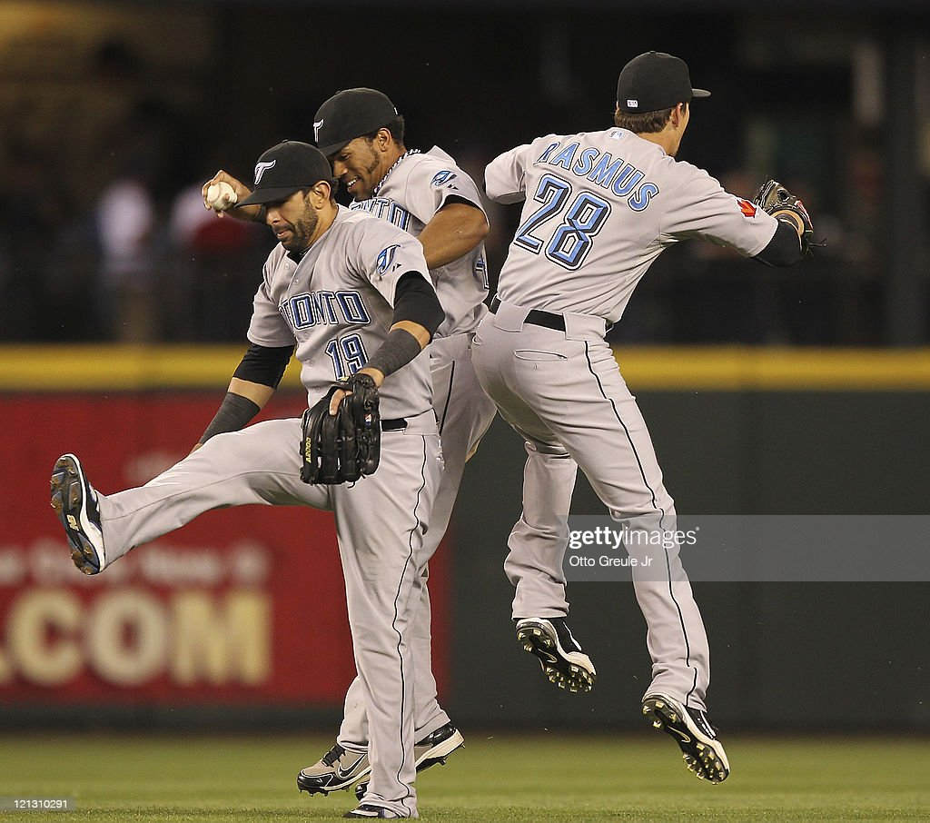 Outfielders Jose Bautista #19, Eric Thames #46, and <a gi-track='captionPersonalityLinkClicked' href=/galleries/search?phrase=Colby+Rasmus&family=editorial&specificpeople=3988372 ng-click='$event.stopPropagation()'>Colby Rasmus</a> #28 of the Toronto Blue Jays celebrate after defeating the Seattle Mariners 5-1 at Safeco Field on August 17, 2011 in Seattle, Washington.
