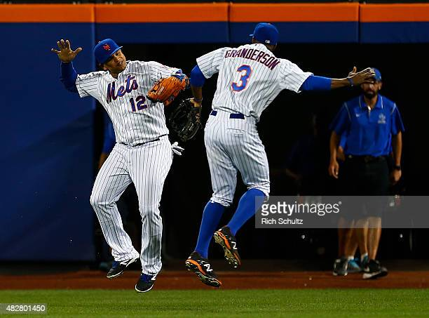 Outfielders Juan Lagares and Curtis Granderson of the New York Mets celebrate after defeating the Washington Nationals 52 on August 2 2015 at Citi...