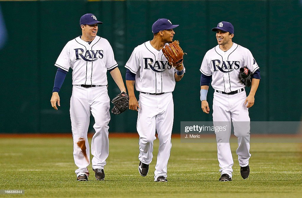 Outfielders Kelly Johnson #2, Desmond Jennings #8 and Sam Fuld #5 of the Tampa Bay Rays celebrate victory over the Toronto Blue Jays at Tropicana Field on May 8, 2013 in St. Petersburg, Florida.