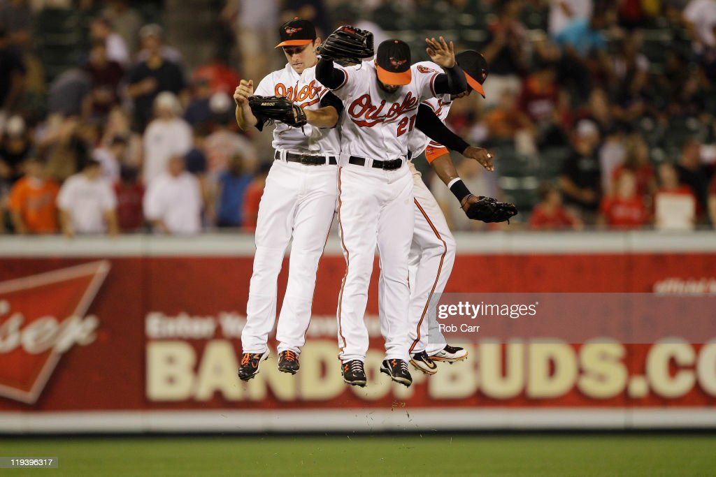 Outfielders Matt Angle Nick Markakis and Adam Jones celebrate the Orioles 62 win over the Boston Red Sox at Oriole Park at Camden Yards on July 19...