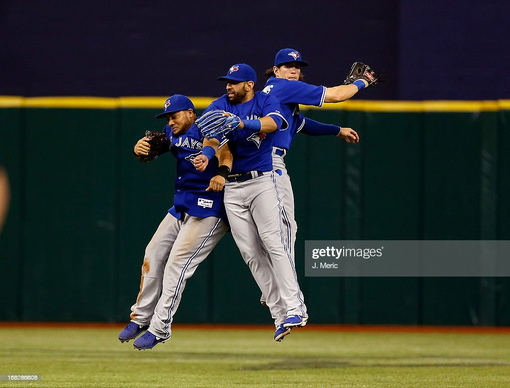 Outfielders (L - R) <a gi-track='captionPersonalityLinkClicked' href=/galleries/search?phrase=Melky+Cabrera&family=editorial&specificpeople=453444 ng-click='$event.stopPropagation()'>Melky Cabrera</a> #53, Jose Bautista #19 and <a gi-track='captionPersonalityLinkClicked' href=/galleries/search?phrase=Colby+Rasmus&family=editorial&specificpeople=3988372 ng-click='$event.stopPropagation()'>Colby Rasmus</a> #28 of the Toronto Blue Jays celebrate victory over the Tampa Bay Rays at Tropicana Field on May 7, 2013 in St. Petersburg, Florida.
