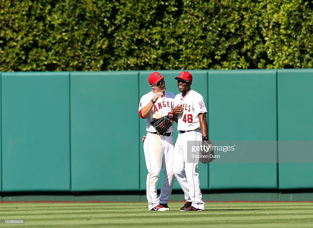 Outfielders <a gi-track='captionPersonalityLinkClicked' href=/galleries/search?phrase=Mike+Trout&family=editorial&specificpeople=7091306 ng-click='$event.stopPropagation()'>Mike Trout</a> #27 and <a gi-track='captionPersonalityLinkClicked' href=/galleries/search?phrase=Torii+Hunter&family=editorial&specificpeople=183408 ng-click='$event.stopPropagation()'>Torii Hunter</a> #48 of the Los Angeles Angels of Anaheim have a laugh in the outfield during a pitching change in the ninth inning against the Chicago White Sox at Angel Stadium of Anaheim on September 23, 2012 in Anaheim, California. The Angels won 4-1.
