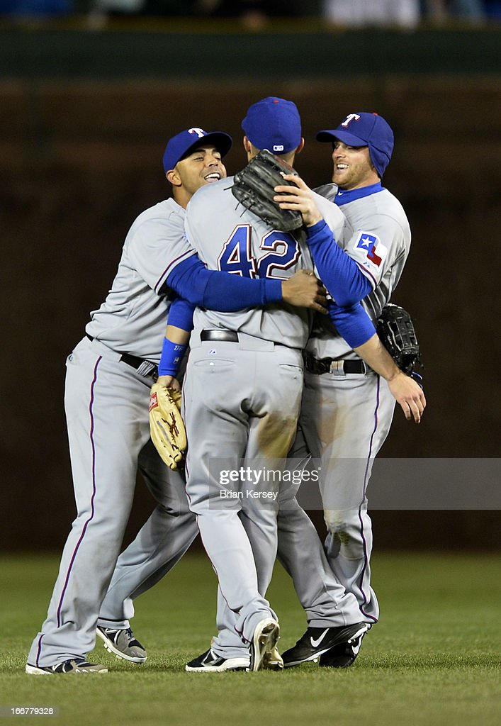 Outfielders <a gi-track='captionPersonalityLinkClicked' href=/galleries/search?phrase=Nelson+Cruz&family=editorial&specificpeople=235459 ng-click='$event.stopPropagation()'>Nelson Cruz</a> (L-R), Jeff Baker and <a gi-track='captionPersonalityLinkClicked' href=/galleries/search?phrase=Craig+Gentry&family=editorial&specificpeople=6352553 ng-click='$event.stopPropagation()'>Craig Gentry</a> of the Texas Rangers celebrate a win over the Chicago Cubs at Wrigley Field on April 16, 2013 in Chicago, Illinois. All uniformed team members are wearing jersey number 42 in honor of Jackie Robinson Day. The Rangers defeated the Cubs 4-2.