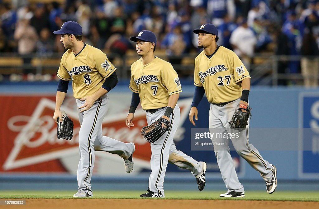 Outfielders Ryan Braun #8, Norichika Aoki #7, and Carlos Gomez #27 of the Milwaukee Brewers run off the field together after the final out of the game against the Los Angeles Dodgers at Dodger Stadium on April 27, 2013 in Los Angeles, California. The Brewers won 6-4.
