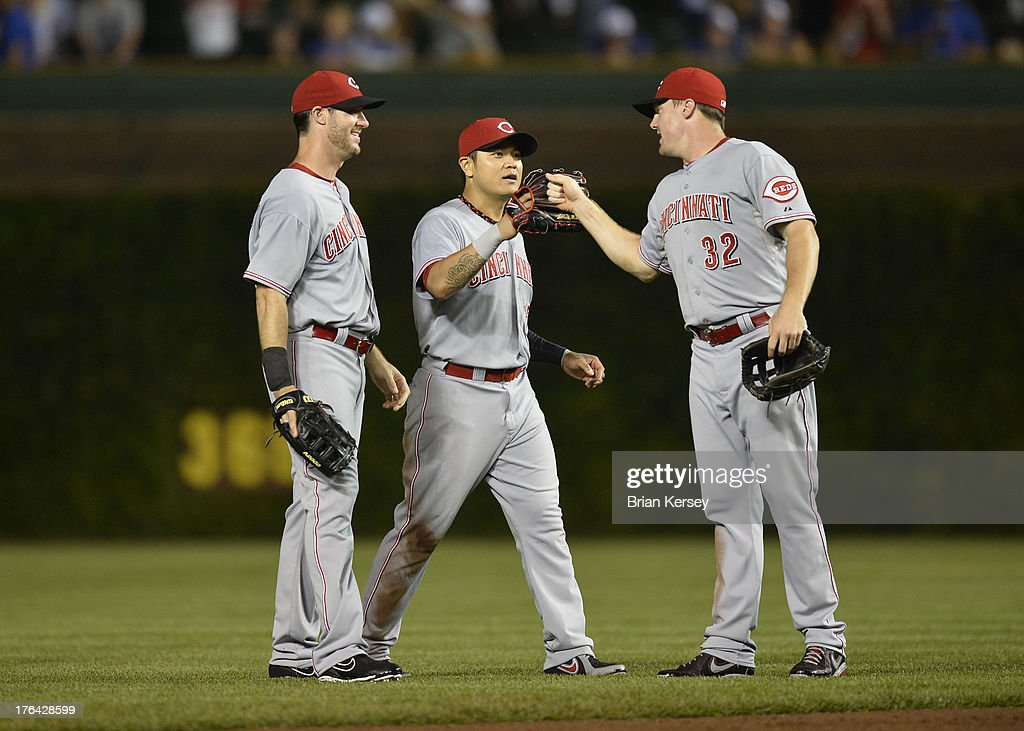 Outfielders <a gi-track='captionPersonalityLinkClicked' href=/galleries/search?phrase=Ryan+Ludwick&family=editorial&specificpeople=834386 ng-click='$event.stopPropagation()'>Ryan Ludwick</a> #48, <a gi-track='captionPersonalityLinkClicked' href=/galleries/search?phrase=Shin-Soo+Choo&family=editorial&specificpeople=196543 ng-click='$event.stopPropagation()'>Shin-Soo Choo</a> #17 and <a gi-track='captionPersonalityLinkClicked' href=/galleries/search?phrase=Jay+Bruce&family=editorial&specificpeople=4391540 ng-click='$event.stopPropagation()'>Jay Bruce</a> #32 of the Cincinnati Reds celebrate their win over the Chicago Cubs at Wrigley Field on August 12, 2013 in Chicago, Illinois. The Reds defeated the Cubs 2-0.