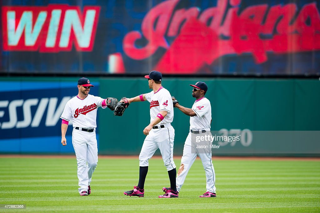 Outfielders <a gi-track='captionPersonalityLinkClicked' href=/galleries/search?phrase=Ryan+Raburn&family=editorial&specificpeople=2541483 ng-click='$event.stopPropagation()'>Ryan Raburn</a> #9 <a gi-track='captionPersonalityLinkClicked' href=/galleries/search?phrase=David+Murphy+-+Baseball+Player&family=editorial&specificpeople=4604222 ng-click='$event.stopPropagation()'>David Murphy</a> #7 and <a gi-track='captionPersonalityLinkClicked' href=/galleries/search?phrase=Michael+Bourn&family=editorial&specificpeople=835742 ng-click='$event.stopPropagation()'>Michael Bourn</a> #24 of the Cleveland Indians celebrate after defeating the Minnesota Twins at Progressive Field on May 10, 2015 in Cleveland, Ohio. The Indians defeated the Twins 8-2.
