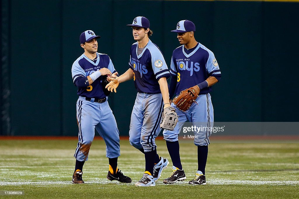 Outfielders <a gi-track='captionPersonalityLinkClicked' href=/galleries/search?phrase=Sam+Fuld&family=editorial&specificpeople=4505687 ng-click='$event.stopPropagation()'>Sam Fuld</a> #5, <a gi-track='captionPersonalityLinkClicked' href=/galleries/search?phrase=Wil+Myers&family=editorial&specificpeople=7562808 ng-click='$event.stopPropagation()'>Wil Myers</a> #9 and <a gi-track='captionPersonalityLinkClicked' href=/galleries/search?phrase=Desmond+Jennings&family=editorial&specificpeople=5974085 ng-click='$event.stopPropagation()'>Desmond Jennings</a> #8 of the Tampa Bay Rays celebrate victory over the Chicago White Sox at Tropicana Field on July 6, 2013 in St. Petersburg, Florida.
