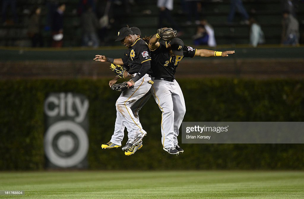 Outfielders <a gi-track='captionPersonalityLinkClicked' href=/galleries/search?phrase=Starling+Marte&family=editorial&specificpeople=7934200 ng-click='$event.stopPropagation()'>Starling Marte</a> #6, <a gi-track='captionPersonalityLinkClicked' href=/galleries/search?phrase=Andrew+McCutchen&family=editorial&specificpeople=2364814 ng-click='$event.stopPropagation()'>Andrew McCutchen</a> #22 and <a gi-track='captionPersonalityLinkClicked' href=/galleries/search?phrase=Marlon+Byrd&family=editorial&specificpeople=217377 ng-click='$event.stopPropagation()'>Marlon Byrd</a> #2 of the Pittsburgh Pirates celebrate their win over the Chicago Cubs at Wrigley Field on September 24, 2013 in Chicago, Illinois. The Pirates defeated the Cubs 8-2.