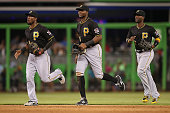 Outfielders Starling Marte Gregory Polanco and Andrew McCutchen of the Pittsburgh Pirates run off the field after defeating the Miami Marlins in the...