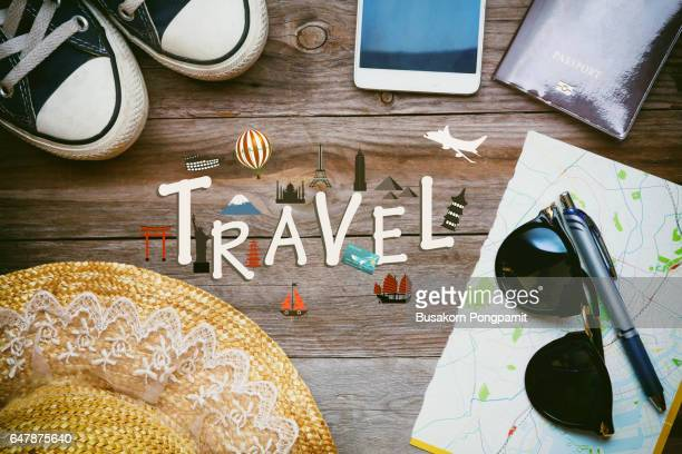 Outfit of traveler on wooden background, Travel the world monument concept