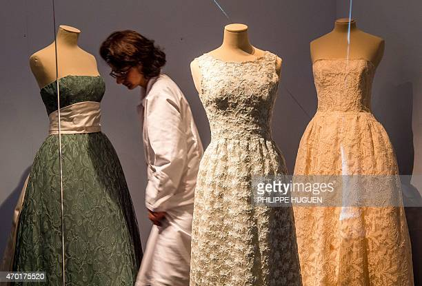 Outfits by couturier Cristobal Balenciaga are displayed at the exhibition 'Balenciaga Master of Lace' on April 15 2015 at the Museum of Lace and...