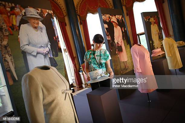 Outfits worn by Queen Elizabeth II for garden parties are shown at The Royal Welcome exhibition Summer opening at Buckingham Palace on July 23 2015...
