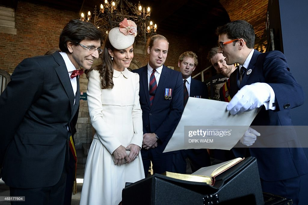 Outgoing Belgian Prime Minister Elio Di Rupo, Duchess of Cambridge Catherine, Britain's Prince William, and Britain's Prince Harry are seen at Mons' city hall on August 4, 2014 in Mons, Belgium, during commemorations marking 100 years since the invasion of Belgium by Germany at the start of World War I. World leaders on August 4 commemorated the 100th anniversary of the outbreak of World War I, a small Balkans conflict that went global with the German invasion of neutral Belgium in August 1914. AFP PHOTO / BELGA / DIRK WAEM **Belgium Out**