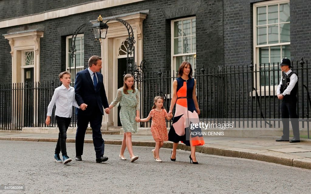 TOPSHOT - Outgoing British prime minister David Cameron (2nd L) leaves after speaking outside 10 Downing Street with his family (L-R) son Arthur Elwen, his daughter Nancy Gwen, daughter Florence Rose Endellion and his wife Samantha Cameron in central London on July 13, 2016 before going to Buckingham Palace to tender his resignation to Queen Elizabeth II. Outgoing British prime minister David Cameron urged his successor Theresa May on Wednesday to maintain close ties with the EU even while negotiating to leave it, as he paid a fond farewell to MPs hours before leaving office. Cameron will tender his resignation on July 13 to Queen Elizabeth II at Buckingham Palace, after which the monarch will task the new leader of the Conservative Party Theresa May with forming a government. PHOTO / Adrian DENNIS