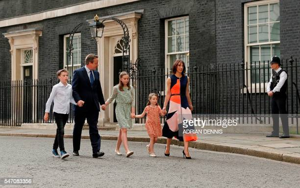 TOPSHOT Outgoing British prime minister David Cameron leaves after speaking outside 10 Downing Street with his family son Arthur Elwen his daughter...