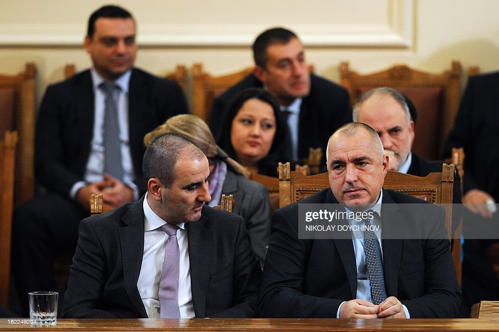 Outgoing Bulgarian Prime Minister Boyko Borisov (R) and Bulgarian Interior Minister Tsvetan Tsvetanov (L) attend the Parliament session in Sofia on February 21, 2013. Bulgaria's parliament accepted today the resignation of Prime Minister Boyko Borisov's government after days of sometimes violent protests against high electricity bills and low incomes in the EU's poorest country.