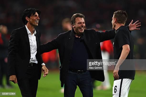 Outgoing CEO Heribert Bruchhagen and manager Bruno Huebner of Frankfurt celebrate with Bastian Oczipka after the Bundesliga Playoff Leg 2 between 1...