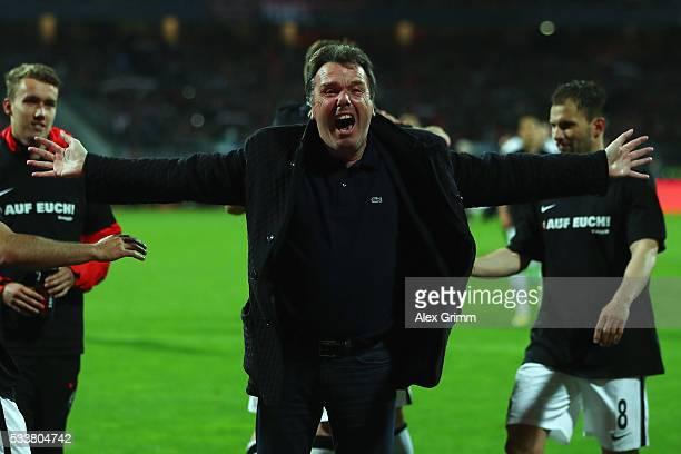 Outgoing CEO Heribert Bruchhagen of Frankfurt celebrates after the Bundesliga Playoff Leg 2 between 1 FC Nuernberg and Eintracht Frankfurt at...