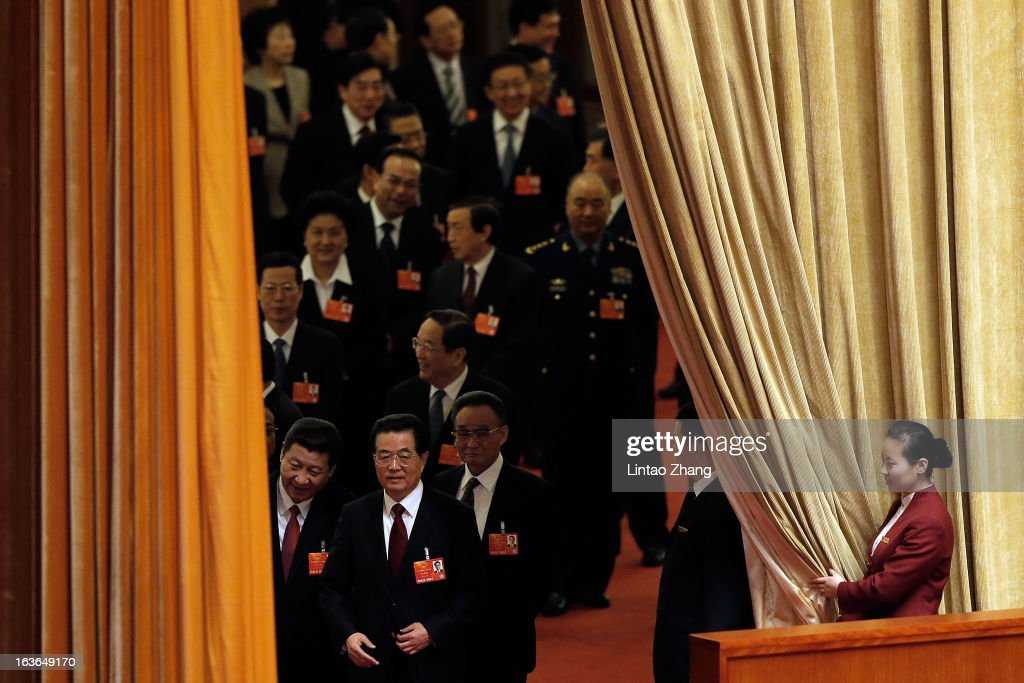 Outgoing Chinese President Hu Jintao and incoming President Xi Jinping attend a plenary session during the fourth plenary meeting of the National...