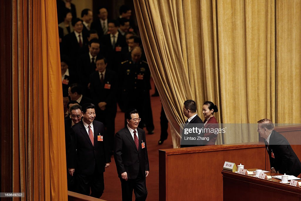 Outgoing Chinese President Hu Jintao (Front )and incoming President Xi Jinping (L) attend a plenary session during the fourth plenary meeting of the National People's Congress (NPC) at the Great Hall of the People on March 14, 2013 in Beijing, China. Xi Jinping, General Secretary of the Communist Party of China Central Committee, was elected President of the People's Republic of China and Chairman of the Central Military Commission on Thursday.