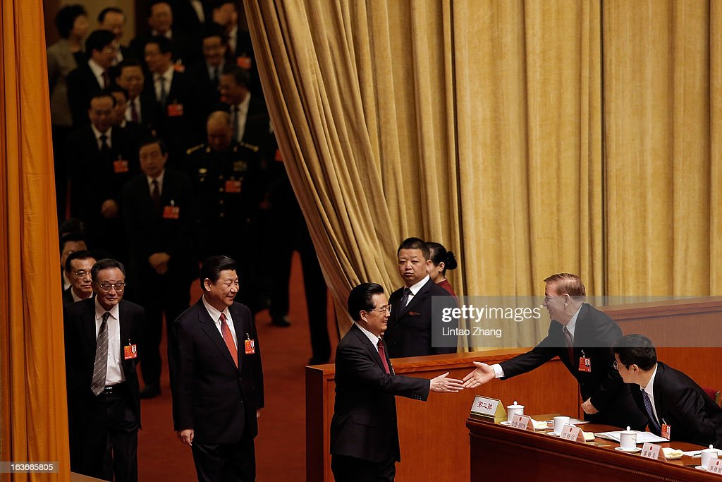 Outgoing Chinese President Hu Jintao (Front )and incoming-President Xi Jinping to attend a plenary session during the fourth plenary meeting of the National People's Congress (NPC) at the Great Hall of the People on March 14, 2013 in Beijing, China. Xi Jinping, general secretary of the Communist Party of China Central Committee, was elected President of the People's Republic of China and Chairman of the Central Military Commission on Thursday.
